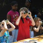 Kids try their hand at spotting birds at the Pine Woods Audubon Society Birdfest. This year's event is scheduled for 1-3 p.m. today at the Hattiesburg Zoo at Kamper Park.