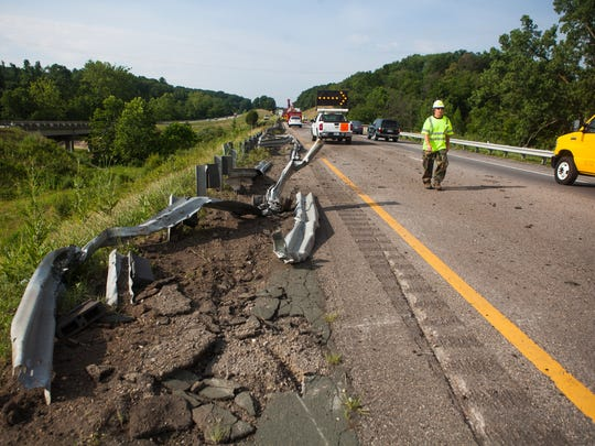 Torn up roadside barriers lie beside I-81 after FedEx ground tractor trailer was involved in an accident near mile marker 225 on Thursday, June 25, 2015.