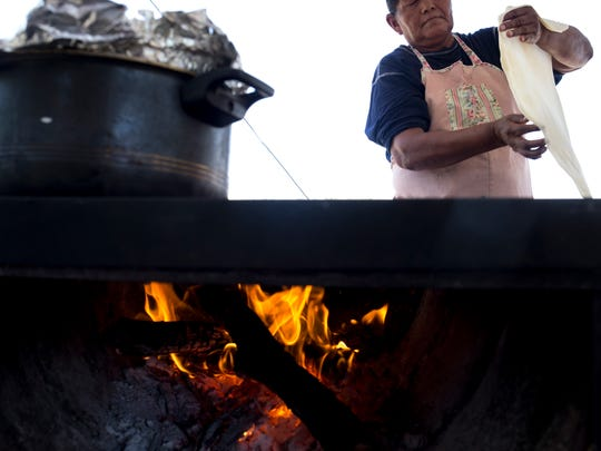 Janet Garcia prepares tortillas in her family's food stand in the Tohono Plaza shopping center in Sells, Arizona.