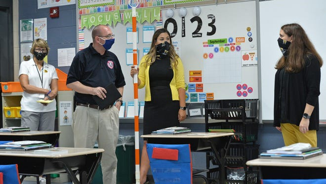 Erie County and Iroquois School District officials show off a classroom Friday at Iroquois Elementary School in Lawrence Park Township that has been prepared for safe COVID-19 protocols. From left are: Karen Barringer, the district's assistant pandemic coordinator; Dan Loewenheim, emergency management specialist with the Erie County Department of Public Safety; Veronica Will, assistant principal of IES; and Jennifer Foutz, principal of IES.