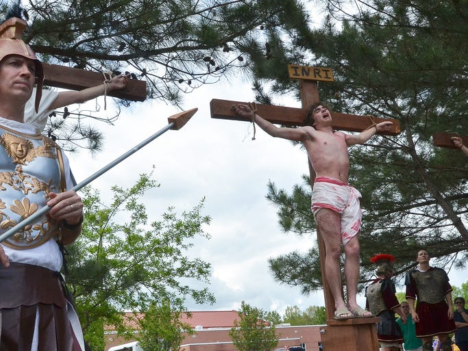 Joseph Strode portrays Jesus as he is crucified during the Live Way of the Cross, a reinactment of the Stations of the Cross, at St. Francis of Assisi in Ridgeland on Good Friday.