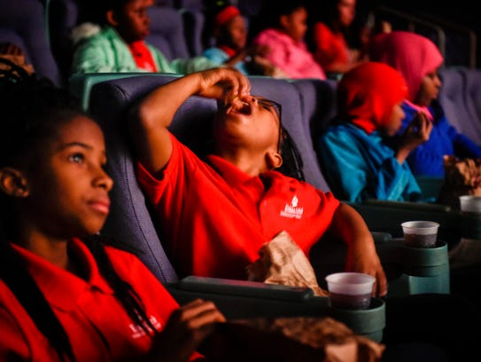 LaRita Patton eats popcorn with the other fourth-graders