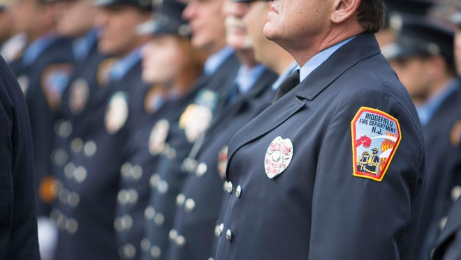 Ridgefield Fire Department members line up during ceremonies commemorating the 50th anniversary of five firefighters who died during a fire at a bowling alley in Cliffside Park. The memorial was held in Ridgefield on Sunday, Oct. 15, 2017.