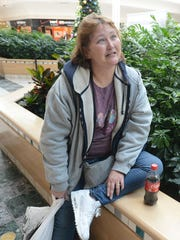 Donna Fletcher of Eden sits after shopping for two days straight.