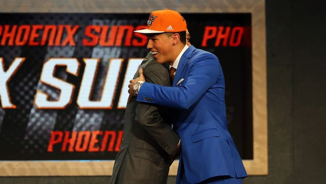 Devin Booker meets with Commissioner Adam Silver after being selected 13th overall in the First Round of the 2015 NBA Draft at the Barclays Center on June 25, 2015 in the Brooklyn borough of  New York City.