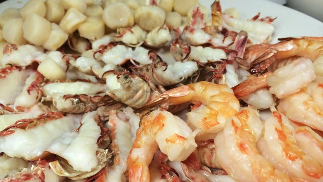 The Cape Canaveral special at Dixie Crossroads in Titusville includes one dozen shrimp, two dozen rock shrimp and a quarter pound of scallops.