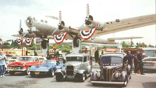 Banners hang from the propellers of the Lacey Lady when the B-17 was perched above the pumps at a gas station on SE McLoughlin Boulevard in Milwaukie.