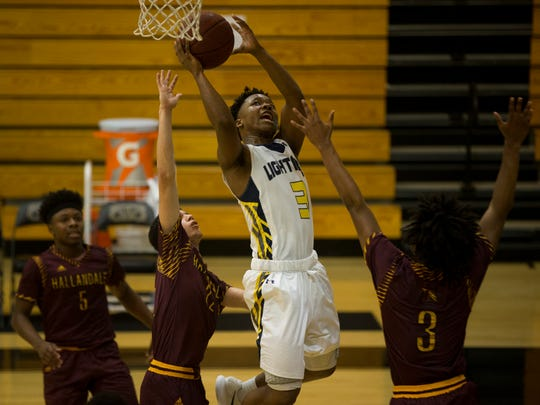 Lehigh's Bernhard Edwards (3) attempts a layup in the second half during a first round game of the Gulfshore Holiday Hoopfest at Golden Gate High School Wednesday, Dec. 27, 2017 in Golden Gate Estates. Lehigh would go on to win 74-68.