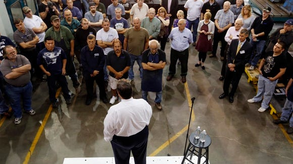 Gov. Chris Christie speaks to employees during a campaign stop at Granite State Manufacturing, Thursday, Oct. 8, 2015, in Manchester, N.H. He's back in New Hampshire today. (AP Photo/Jim Cole)