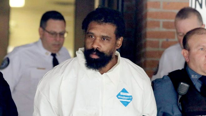 Grafton Thomas is led from Ramapo Town Hall in Ramapo following his arraignment on Dec. 29.