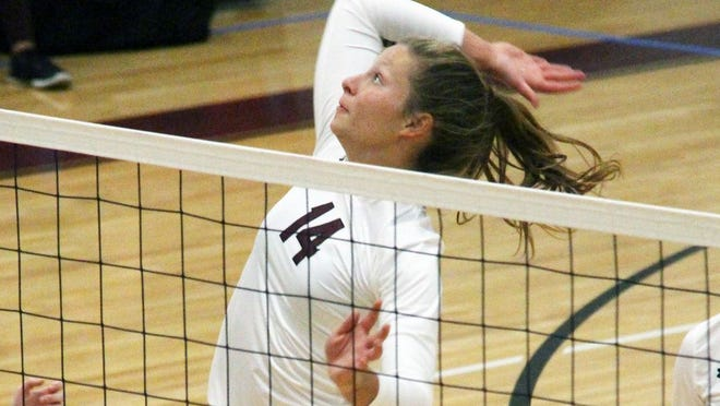 Osage senior Sara Wolf rises above the net for a spike on Thursday, September 10, in Osage Beach. Wolf led her team with 17 kills on the night.