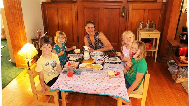 Students of Wildwood Montessori enjoy a deilcious lunch with their Guide Leader. From left, are: Eli, Brenna, Clarissa Sparkl, Taya, and Hannah.