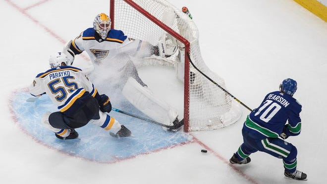 Vancouver Canucks' Tanner Pearson (70) is stopped by St. Louis Blues goalie Jake Allen (34) as Colton Parayko (55) defends during the second period of an NHL Western Conference Stanley Cup playoff series, in Edmonton, Alberta, Friday, Aug. 21, 2020.