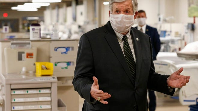 Missouri Governor Mike Parson speaks after touring the coronavirus ward at Cox South on Monday, May 4, 2020.