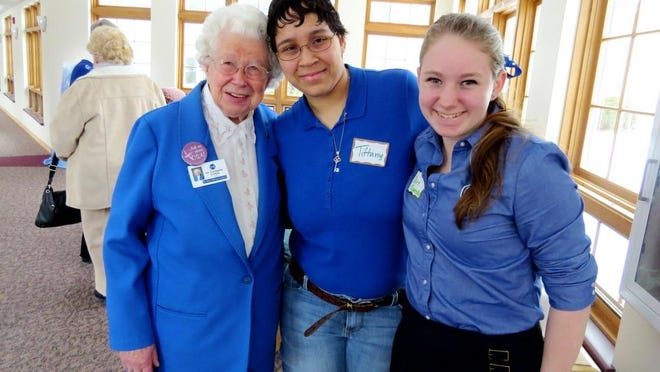 Sister Germaine Lichtle, at left, a long-time tutor at St. Mary's Springs Academy, welcomed volunteers from the school who helped CSA at its Open House on Feb. 8. She poses alongside Tiffany Alequin, center, and Claire Dugenske.