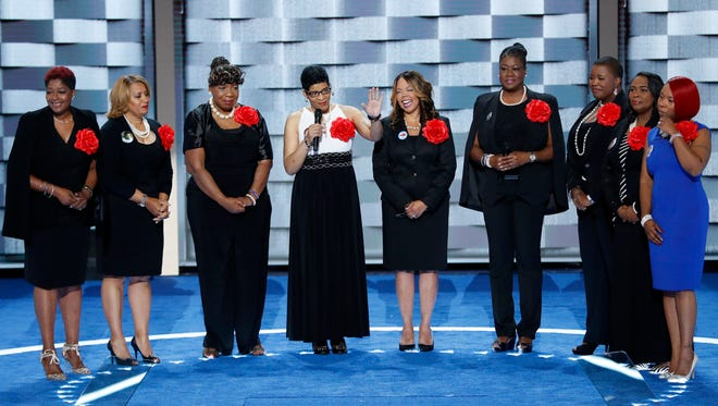 Sybrina Fulton, Geneva Reed-Veal, Lucy McBath, Gwen Carr, Cleopatra Pendleton, Maria Hamilton, Lezley McSpadden and Wanda Johnson from Mothers of the Movement speak during the second day of the Democratic National Convention in Philadelphia.