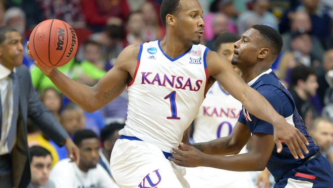 Mar 19, 2016; Des Moines, IA, USA; Kansas Jayhawks guard Wayne Selden Jr. (1) looks to drive against the Connecticut Huskies during the second round of the 2016 NCAA Tournament at Wells Fargo Arena.