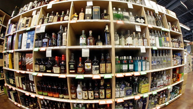 This June 16, 2016, file photo, taken with a fisheye lens, shows bottles of alcohol during a tour of a state liquor store, in Salt Lake City. Utah is set to have the lowest   legal threshold for drunken driving – a .05 percent blood-alcohol content – in the nation.