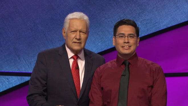 "Wellington Landing Middle School teacher Christopher Cartagena  with host Alex Trebek during his appearance on ""Jeopardy!"" Episode to air at 7:30 on Tuesday, Feb. 25, 2020."