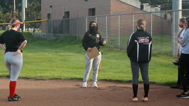 Monmouth College softball coach Alexa McClaughry talks to members of her team before a recent fall ball workout.