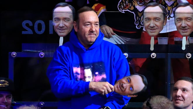 """Actor Kevin Spacey attends a game between the Red Wings and Panthers in the second period of at BB&T Center Saturday. Spacey is considered a good luck charm as the player of the game is given a """"Spacey in Space"""" sweatshirt."""