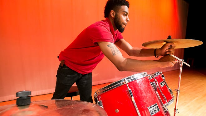 Clinton Brown sets up his drums for the music and dance portion of the African American  Cultural celebration held at Patterson Park Community Center. Jan. 28, 2016