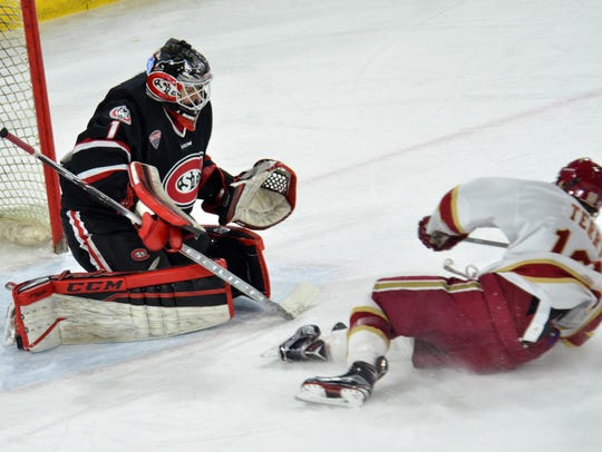 Denver's Troy Terry slides with with the puck toward