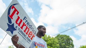 Fredrick Turner, democratic candidate for Montgomery School Board District 1, assembles a yard sign in the back of his truck, Saturday, June 16, 2018, as he campaigns to win the runoff in the Pecan Grove neighborhood of Montgomery, Ala.