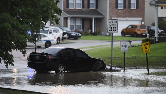 A car was swept away during flooding in North Nashville on Ewing Creek at the corner of Gwynwood Dr and Ewingdale Thursday July 7, 2016, in Nashville, Tenn.