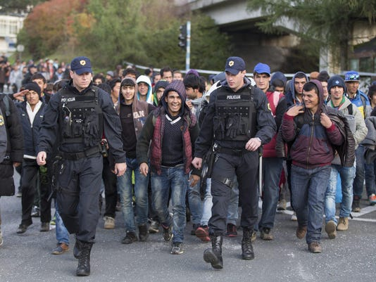 Refugees travelling through Slovenia arrive at the Spielfeld border