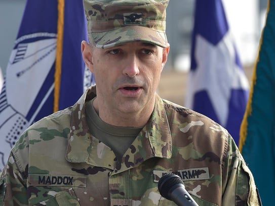 Col. Deacon Maddox speaks during a groundbreaking ceremony
