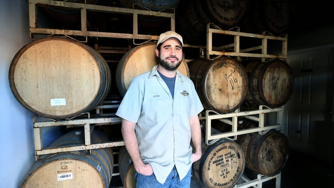 Jason Roeper, owner of Rivertown Brewing Company, stands near barrels of beer that his company makes in Lockland. Open only five years, Rivertown is one of the oldest local breweries. It is now completely rebranding, with new beers, new labels, changes to the tap room and more. Photo shot Thursday February 5, 2015. The Enquirer/ Cara Owsley.