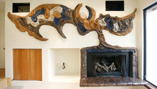 Fire place in the living room of the house up for sale that architect James Johnson designed at 86 Mountain Road in Penfield.