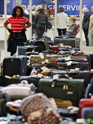 Zanor McWilliams of Stone Mountain, Ga., said she was stuck on the tarmac for eight hours on Sunday at Hartsfield-Jackson Atlanta International Airport, and returned Monday to try to collect her luggage. Passengers were still feeling the effects of Sunday's power outage at the Atlanta airport as they had to endure long lines to claim baggage and ride shuttles.