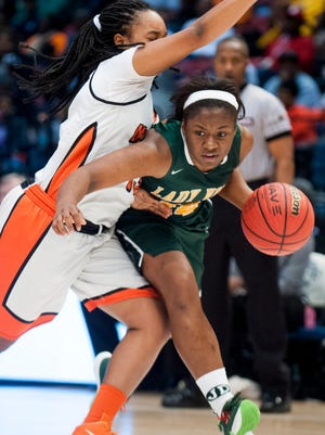 Jeff Davis' Tia Manora drives against McGill-Toolen's Sarah Pierre in the AHSAA basketball championship game at Legacy Arena in Birmingham, Ala. on Saturday March 5, 2016.