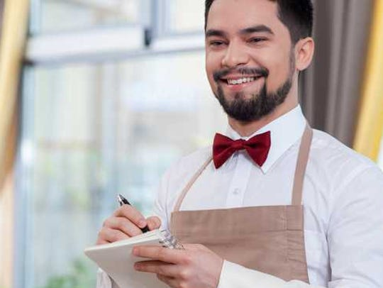 A waiter taking a dining order.