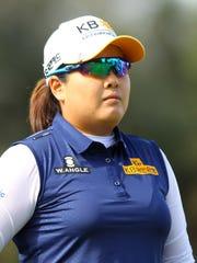 2013 winner Inbee Park follows her tee shot on the