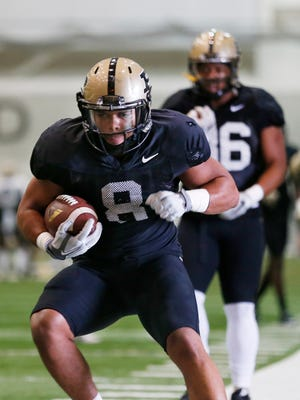 Markell Jones carries the ball during Purdue spring football practice Thursday, April 7, 2016, inside the Mollenkopf Athletic Center.