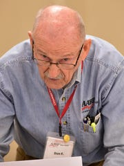 Don Florwick prepares customer taxes at the AARP Tax-aide