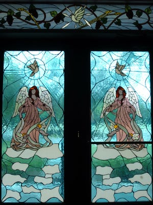 A fundraiser for hurricane victims will be 4 p.m. Feb. 25, at St. Augustine of Canterbury Episcopal Church on 43rd Avenue in Vero Beach.    One of Elsie Sheppard's stained glass windows decorates the doors of  St. Augustine of Canterbury Episcopal Church.    cq: Elsie Sheppard   photo taken on March 20, 2007 art