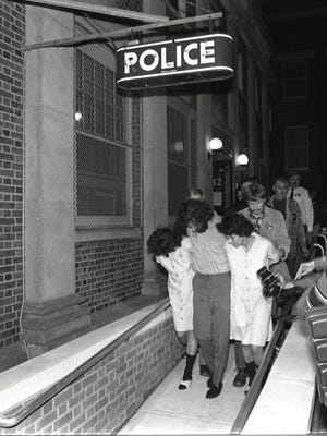 Suspects Kathy Boudin, David Gilbert, (who gave his name as James Hackforth) and Judith Clark are lead from Nyack Police Headquarters after their arraignment after the Oct. 20, 1981 Brinks robbery that left two Nyack Police officers and a Brink's guard dead.