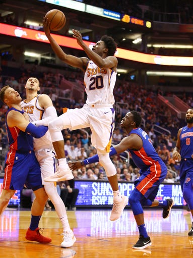 Phoenix Suns' Josh Jackson jumps to the basket against