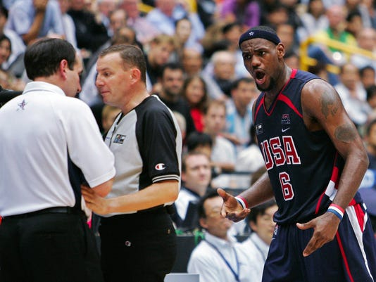 FILE - This Sept. 1, 2006 file photo shows USA's LeBron James looking to coach Mike Krzyewski after being called for a technical foul late in their game against Greece at the semifinals of the World Basketball Championships in Saitama, Japan. Ten years ago, a U.S. team coached by Krzyzewski and featuring LeBron James and a few other likely Hall of Famers lost to a Greece squad with no NBA players. Whether it was an upset depends on which side you ask, but there's no debating what it meant to a U.S. team that hasn't lost since. The Americans roll into Rio now. Greece plays in a tournament, starting Tuesday, July 5, 2016, to qualify. People on both sides remembered the buildup, the game and the aftermath. (AP Photo/Mark J. Terrill, File)