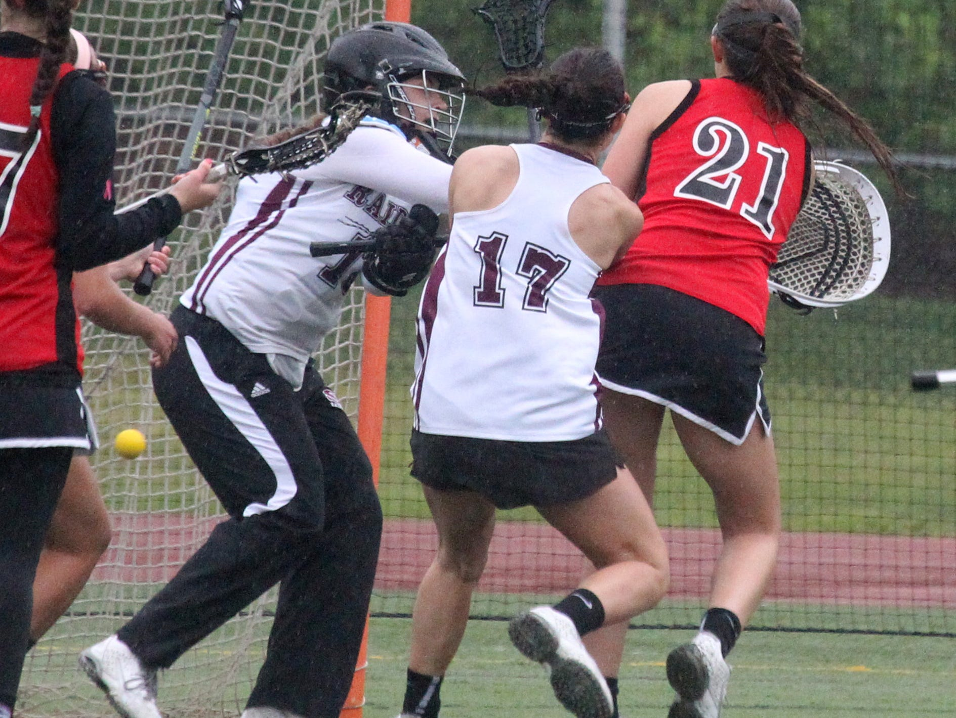 Rye's Abby Abate (21) scores past Scarsdale goalie Angie Burns at Scarsdale May 13, 2016. Rye won 10-9.