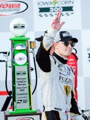 Josef Newgarden (21) celebrates his victory at the IndyCar series Iowa Corn 300 on Sunday, July 10, 2016, at the Iowa Speedway in Newton.