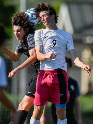 Station Camp's Riley Indermuehle (8) goes for a header with Houston's Kyle Heintz (9) during the second half of the Class AAA championship game at the Richard Siegel Soccer Complex in Murfreesboro, Tenn., Friday, May 26, 2017.