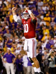 Alabama quarterback AJ McCarron celebrates after throwing a game-winning touchdown pass to running back T.J. Yeldon during the fourth quarter of a Nov. 3 game against LSU. Derick E. Hingle/USA TODAY November 3, 2012; Baton Rouge, LA, USA; Alabama Crimson Tide quarterback AJ McCarron (10) celebrates after throwing a game winning touchdown pass to running back T.J. Yeldon (not pictured) against the LSU Tigers during the fourth quarter of a game at Tiger Stadium. Alabama defeated LSU 21-17. Mandatory Credit: Derick E. Hingle-USA TODAY Sports