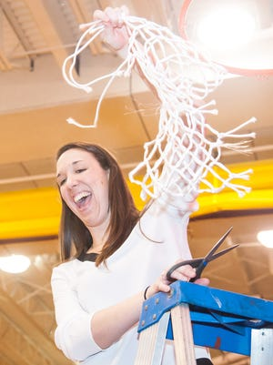Salisbury head coach Kelly Lewandowski cuts down a portion of the net after winning the Capital Athletic Conference Championship against Mary Washington in the Capital Athletic Conference finals on Feb. 28.