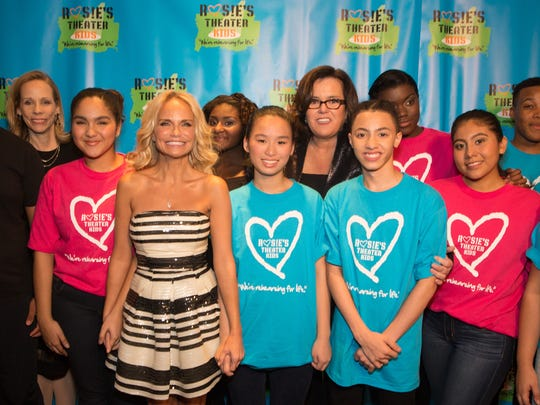 Kristin Cheoweth, Rosie O'Donnell and Lori Klinger pose with students served by O'Donnell and Klinger's Rosie's Theater Kids, who performed at a gala Nov. 2 in New York.