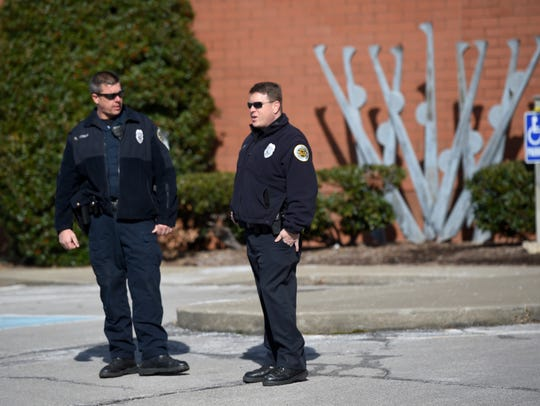 Police stand outside the Gordon Jewish Community in